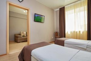 A bed or beds in a room at Hotel Anzas