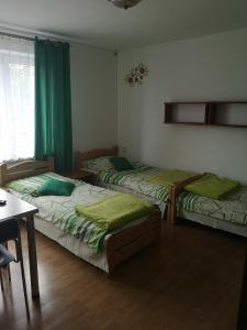 A bed or beds in a room at ZAJAZD NA GRONICKU