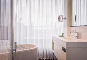 A bathroom at SO/Berlin Das Stue