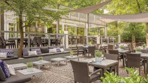 مطعم أو مكان آخر لتناول الطعام في هيلتون ميونيخ بارك