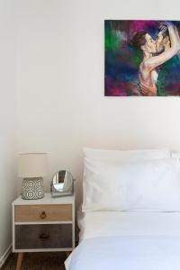 Ένα ή περισσότερα κρεβάτια σε δωμάτιο στο Art Island House