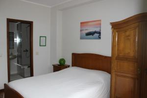 A bed or beds in a room at Rêve D'Or