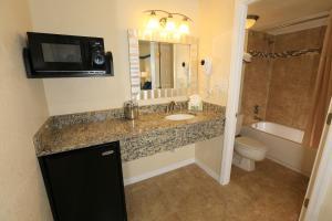 A bathroom at SureStay Plus by Best Western Orlando International Drive