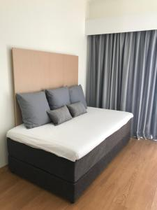 A bed or beds in a room at Stay Hotel Coimbra Centro