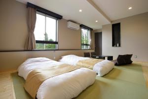 ロイヤルホテル河口湖にあるベッド