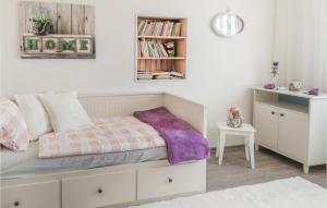A bed or beds in a room at Holiday home Tursko AB-712