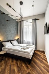 A bed or beds in a room at Apartamenty Nowa Kamienica Częstochowa Centrum Szymanowskiego 22A
