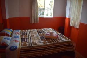Un ou plusieurs lits dans un hébergement de l'établissement Caroline lodging