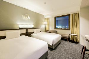 A bed or beds in a room at Four Points by Sheraton Hakodate