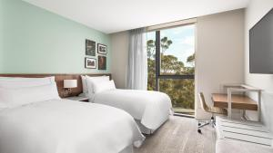 A bed or beds in a room at Element Melbourne Richmond