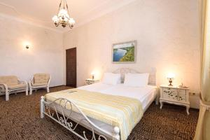 Кровать или кровати в номере Спа отель «Шато Спас»