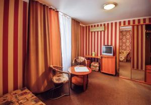 Телевизор и/или развлекательный центр в Tet-a-Tet Guest House