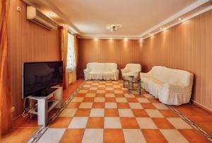Гостиная зона в Tet-a-Tet Guest House