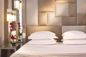 Un ou plusieurs lits dans un hébergement de l'établissement Hôtel A La Villa des Artistes