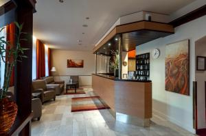 The lobby or reception area at Club Hotel Cortina