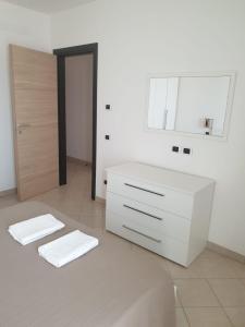 Um banheiro em Aparthotel Por do Sol