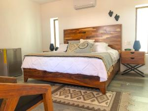 A bed or beds in a room at Villa San Juan Bed&breakfast