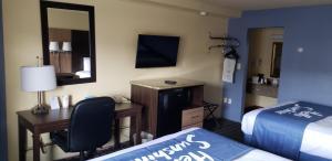 A television and/or entertainment centre at Days Inn by Wyndham Tonawanda/Buffalo
