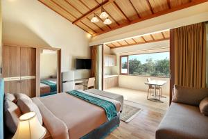 A bed or beds in a room at Puri Sabina Bed & Breakfast
