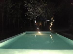 The swimming pool at or near Kampuak Cottages