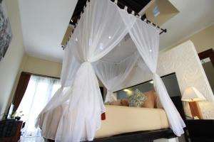 ニケ ヴィラスにあるベッド