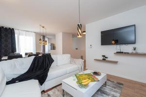 A television and/or entertainment centre at LUXURIUS PENTHOUSE