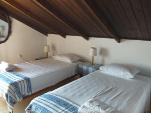 Ένα ή περισσότερα κρεβάτια σε δωμάτιο στο Villa Pachino