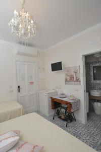 A television and/or entertainment centre at A casa di Nonna Bianca