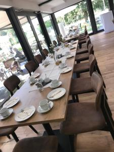 A restaurant or other place to eat at Landcafe Neumann