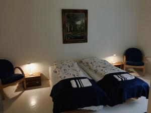 A bed or beds in a room at Senjagarden