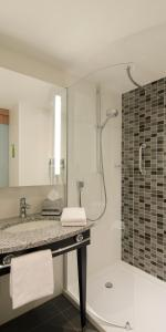 A bathroom at Hampton By Hilton Hamburg City Centre