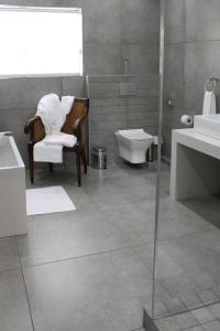 A bathroom at Sheppard Boutique Guest House