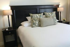 A bed or beds in a room at Sheppard Boutique Guest House