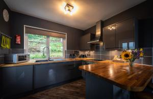 A kitchen or kitchenette at Storr Apartments