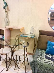 A seating area at Life Resort - Flat Aconchegante