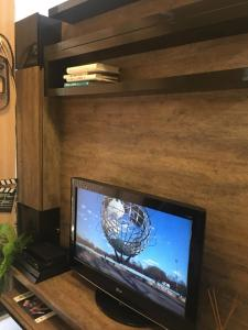 A television and/or entertainment centre at Life Resort - Flat Aconchegante