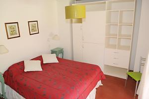 A bed or beds in a room at Cabañas San Dionisio