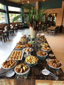 A restaurant or other place to eat at Hotel Fazenda Vale das Pedras