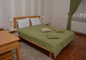 Krevet ili kreveti u jedinici u okviru objekta Garni Hotel Belvedere