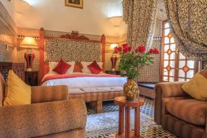 A bed or beds in a room at Palais Dar Donab
