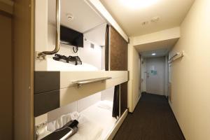 A bathroom at Dormy Inn Global Cabin Asakusa