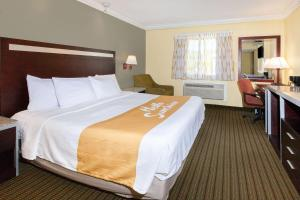 A bed or beds in a room at Days Inn by Wyndham Nanuet / Spring Valley