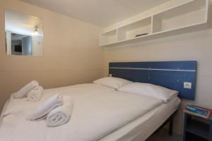 Ein Bett oder Betten in einem Zimmer der Unterkunft Camping Glavotok