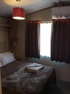 A bed or beds in a room at Creta Camping