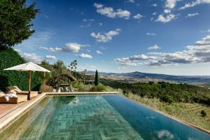The swimming pool at or near Castello Di Vicarello