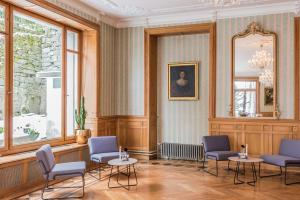 A seating area at Hotel Beau Séjour Lucerne
