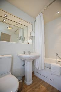 A bathroom at Castle and Ball by Greene King Inns