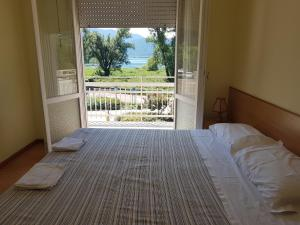 A bed or beds in a room at Albergo Meridiana