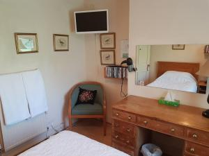 A bed or beds in a room at KEYFIELD TERRACE SERVICED APARTMENTS