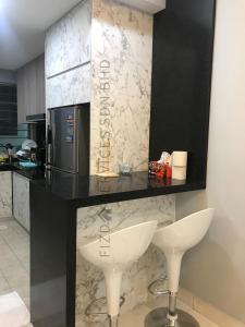 A bathroom at Cozy Apartment @ Hospital Sungai Buloh